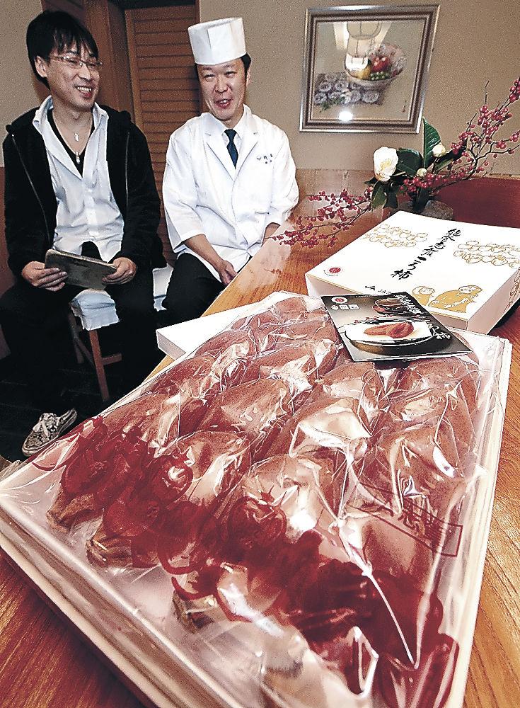 10万円で競り落とされた20個入りの「能登志賀ころ柿」=金沢市片町2丁目の日本料理「銭屋」