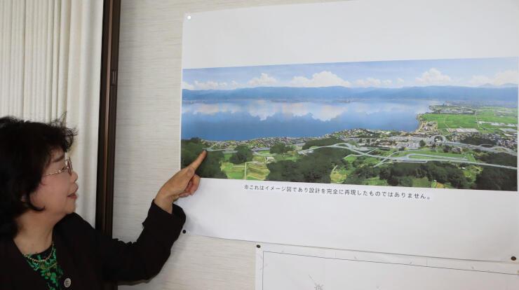 完成予想図上の「由布姫橋」を示す松瀬さん