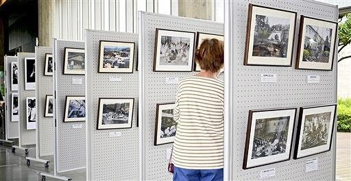ハンセン病患者が強制隔離されていた収容施設などの写真が並ぶパネル展=6月2日、福井県福井市の県立図書館