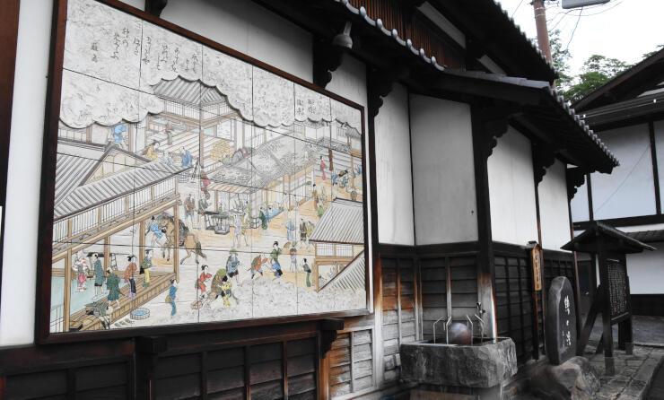下ノ諏訪宿の中心にあった「綿の湯」の跡。宿場風景を描いたレリーフがある