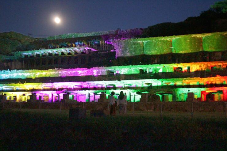 五輪をイメージした5色で照らされた佐渡金銀山の関連遺産「北沢浮遊選鉱場跡」=22日夜、佐渡市相川北沢町